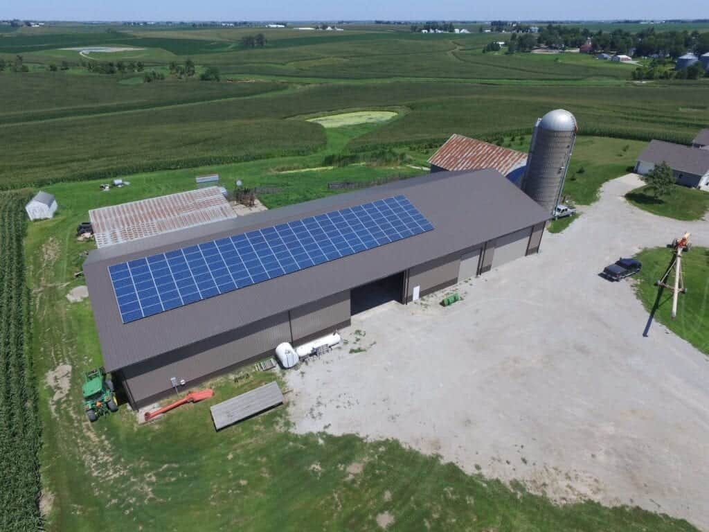54 solar panels on barn roof and Tesla batteries