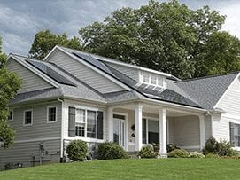 white and gray home with rooftop solar