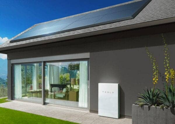 zep solar hardware on roof with tesla powerwall on ground