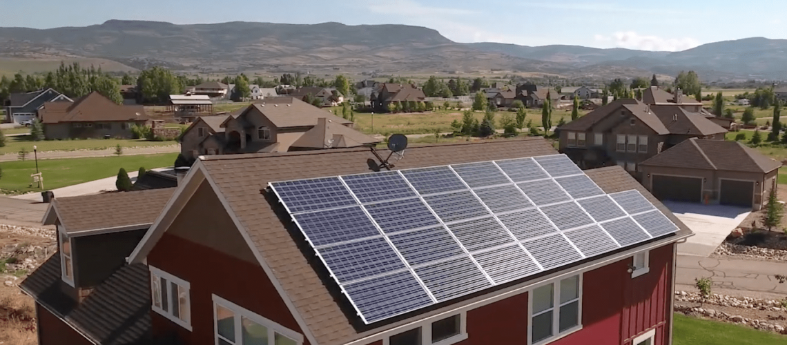 beautiful-red-home-with-rooftop-solar-panels.png