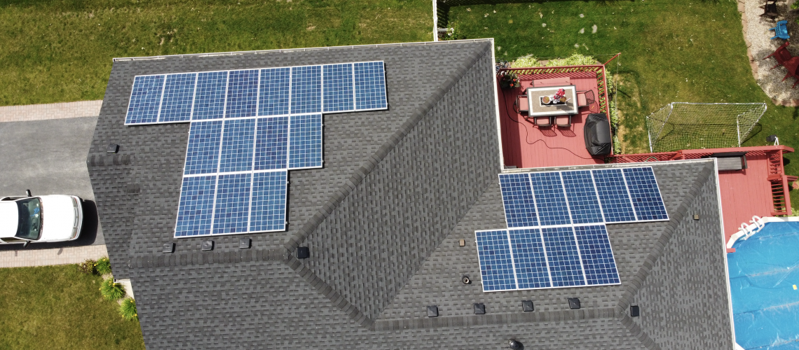 bright solar panels next to pool on house